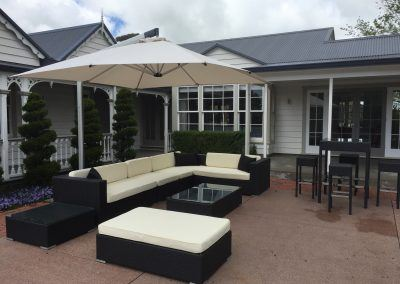 black-rattan-lounge-set-with-canter-lever-umbrella-and-bar-table-with-stools